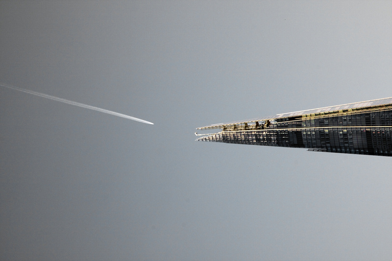 Jet with vapour trail appears to aim for the tip of London's The Shard.